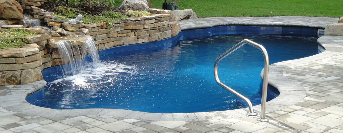 How do they build a swimming pool building an inground swimming pool gunite swimming pool for Cost of swimming pool installation inground